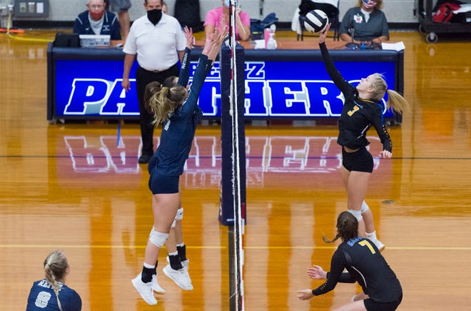 Castle's Olivia Patton (3) spikes the ball as the Castle Lady Knights Thursday evening, Aug. 27, 2020.
