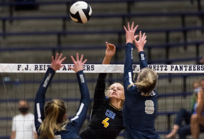 Castle's Natalie Niehaus (4) shoots past Reitz's Ashley Danks (7) and Evie Duncan (8) as the Reitz Lady Panthers play the Castle Lady Knights  Thursday evening, Aug. 27, 2020.