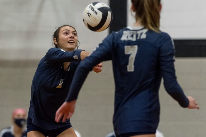 Reitz's Kaleigh Meritt (1) sets the ball as the Reitz Lady Panthers play the Castle Lady Knights Thursday evening, Aug. 27, 2020.