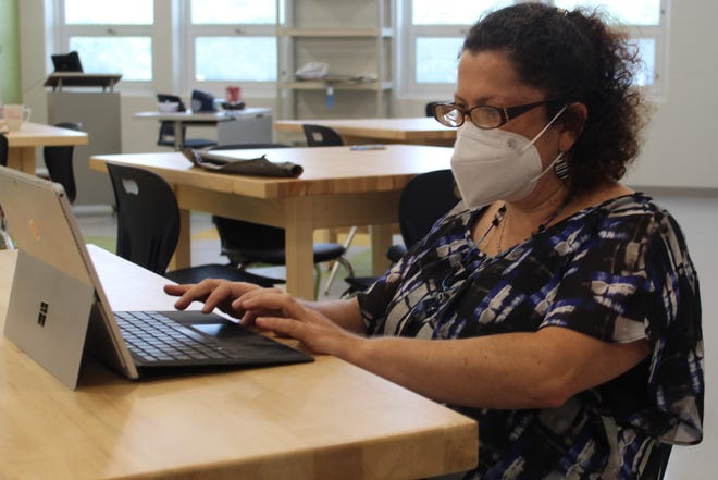 Svetlana Tarnavsky, an art teacher at Otis and Atkinson Elemntary Schools, prepares for the start of the 2020-2021 school year Tuesday at the new Otis building. Fremont City Schools will be opening four new elementary school buildings at its Otis, Atkinson, Croghan and Otis Elementary sites.