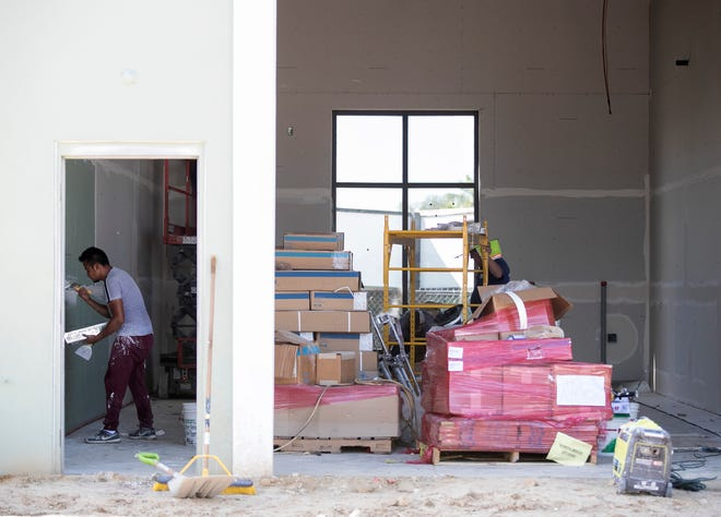 Drywall is being finished inside the luxury auto condos under construction at Bonita Breeze on Bonita Beach Road on Thursday, August 28, 2020, in Bonita Springs.