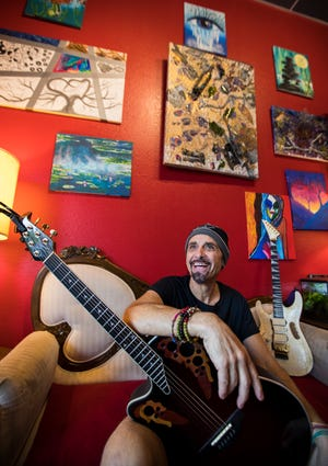 Chris Durso, owner of Educators Music in Cape Coral, poses for a portrait in the cafe area of his store. He is also a veteran guitar player including currently with local bands.