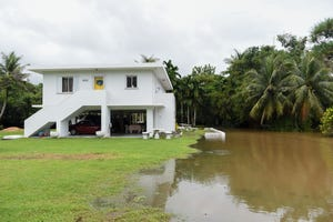 Heavy flooding occured at the Palomo residence following a downpour in Merizo in this Aug. 28 file photo. A flash flood watch in effect for Guam and Rota beginning at 6 p.m.