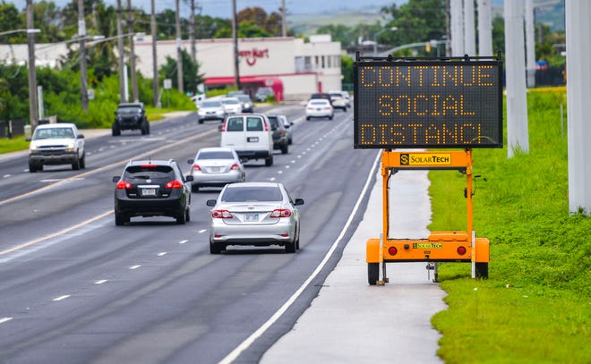A solar-powered sign placed along Army Drive, or Route 16, in Barrigada, flashes advice to passing motorists on how we can stem the spread of the COVID-19 pandemic, on Friday, Aug. 28, 2020.