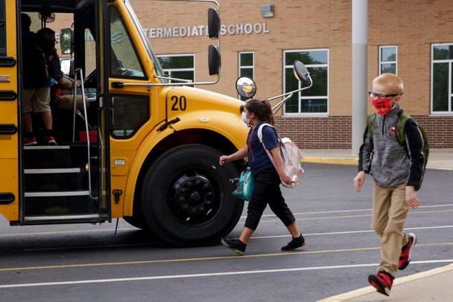 Students depart from Lafayette Sunnyside Intermediate School for their busses, Friday, Aug. 28, 2020 in Lafayette.