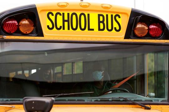 A bus leaves Lafayette Sunnyside Intermediate School, Friday, Aug. 28, 2020 in Lafayette.