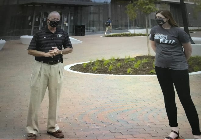 Purdue President Mitch Daniels, left, with Maddie Deselem, a Protect Purdue student ambassador, made a pitch Friday, Aug. 28, 2020, in a video for students to continue to observe social distancing and to be careful during the weekend, as the university finished its first week of in-person classes during the fall semester.