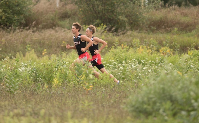 Pinckney's Caleb Jarema (right) and Gavin White rank second and third, respectively, on the Livingston County cross country honor roll.