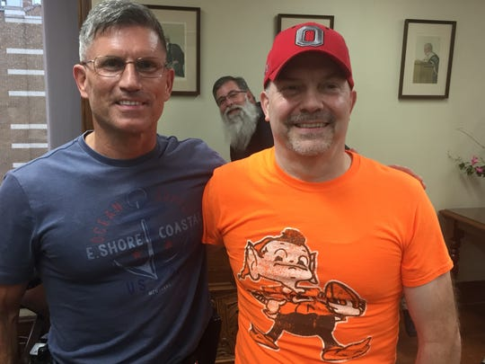 John Mayer, right, poses with twin brother Luke at John's retirement reception on Friday. Richland County probation officer Dave Pittman photobombs the picture in the back.