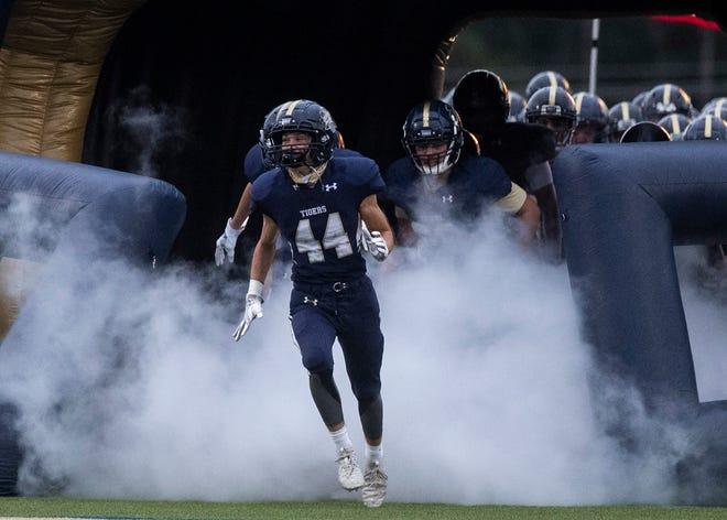 Arlington players take the field for a high school football game on Friday, August 27, 2020, in  Arlington Tenn.,
