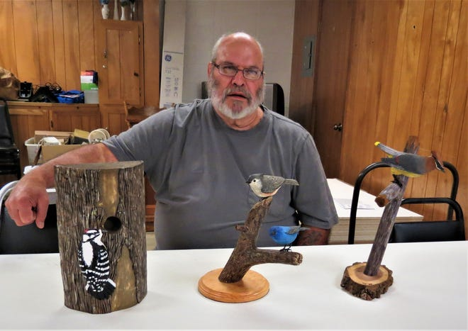 Marty Wells displays some of his woodcarving birds during a recent class of the North Arkansas Woodcarvers Club. The Woodcarvers Club meets at 8 a.m. on Thursdays at VFW Post 3246 at the corner of 7th and Gray streets.