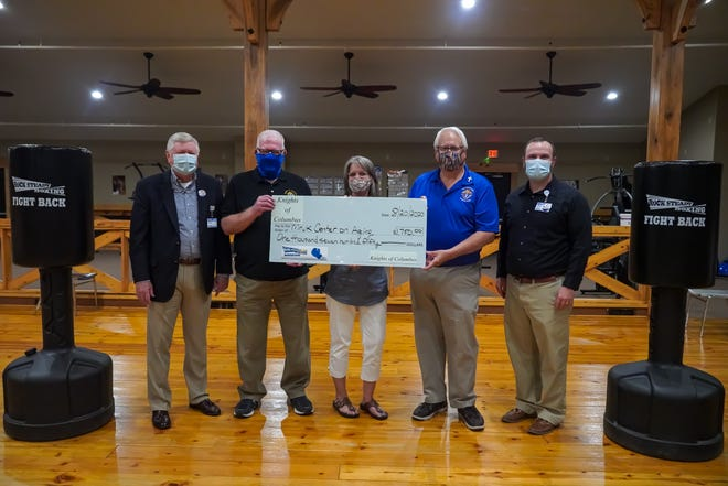 The Mruk Family Education Center on Aging recently received a donation from the Knights of Columbus for the Rock Steady Boxing program. Sown above are (from left) Barney Larry, Paul Mruk, Diahanne VanGulick, Tom Kaster and Justin Woods.