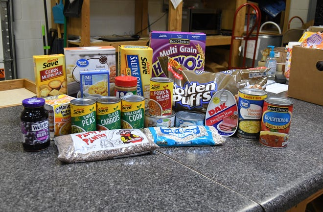 Popular items distributed to clients at the Mountain Home Food Basket are seen on a counter top recently in the facility's storeroom area. The Food Basket will hold a month-long online food drive in September in recognition of its 35th anniversary.