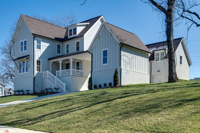 This five bedroom home built by Carbine & Associates in Nature's Landing has a great front porch and sidewalks throughout helping safely connect neighbors.