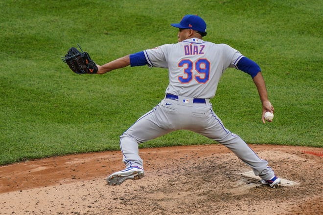 New York Mets relief pitcher Edwin Diaz throws in the seventh inning of the first baseball game of a doubleheader against the New York Yankees, Friday, Aug. 28, 2020, in New York. (AP Photo/John Minchillo)
