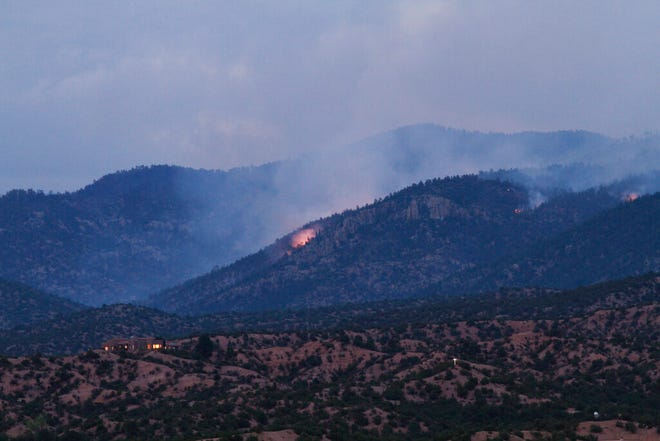 Smoke drifts from fires Thursday, Aug. 27, 2020, in Pecos National Forest near Santa Fe, N.M. As of Thursday the fire, started by a lightning strike, had not posed a risk to life or property. But the smoke that wafts across the county each day is a reminder of growing fire risk along a forest edge that is drier and more populated each decade.