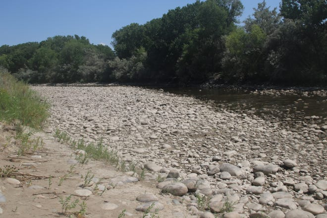 A good portion of the Animas River bed lies exposed to the sun on Aug. 26, 2020, in Berg Park in Farmington after another summer of below-average rainfall.