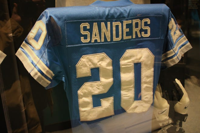 """A jersey and gloves worn by Detroit Lions Hall of Fame running back Barry Sanders is included in the """"Gridiron Glory"""" exhibition at the Farmington Museum at Gateway Park."""