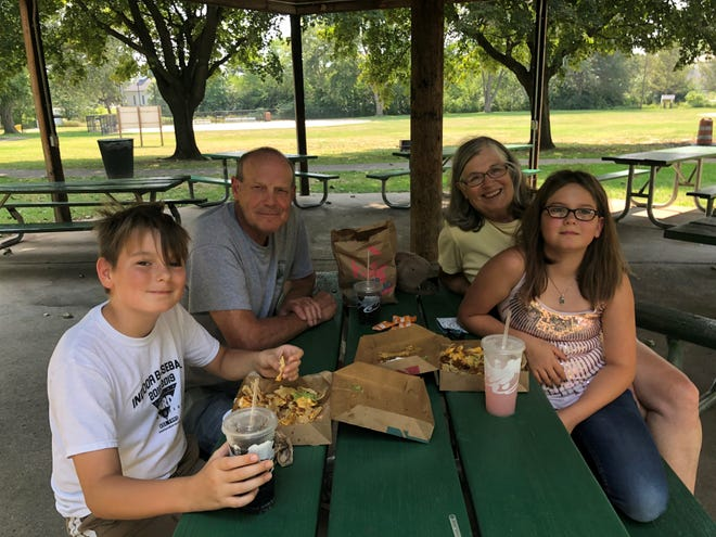 Holly and Henry Schlusler of South Lyon celebrate the 10th birthday of twin grandchildren Addy and Ody on Aug. 27, 2020 at McHattie Park. The family reflected on how they spend a pandemic summer.