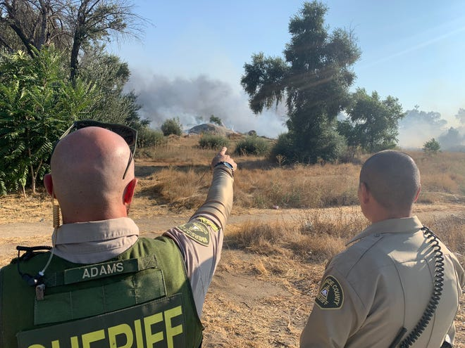 A vegetation fire burns in the western end of Perris on Thursday, Aug. 27, 2020.