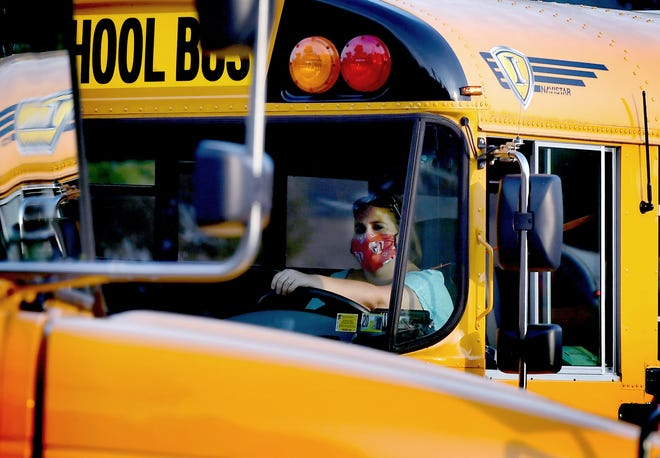 A bus driver exits Central York High School on the first day of classes Friday, August, 28, 2020. The Central School District opted for in-person attendance. Bill Kalina photo