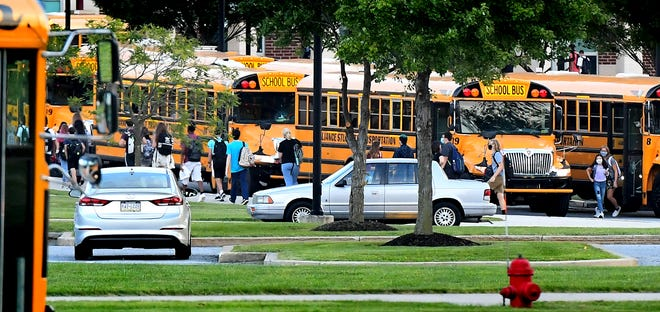 Students exit buses on the first day of classes at Central York High School Friday, August, 28, 2020. The Central School District opted for in-person attendance. Bill Kalina photo