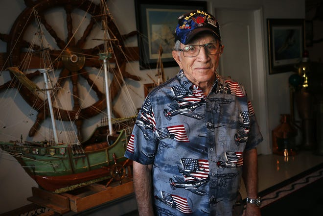 """World War II veteran Gilbert """"Gil"""" Sanchez, Navy/Coast Guard, poses for a portrait at his home in Reno on Aug. 28, 2020."""