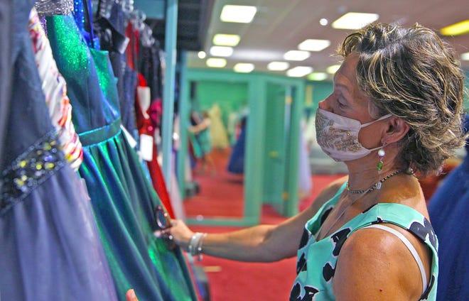 Patty Korona Bunyard, owner of Korona's Formal Wear in San Angelo, looks over inventory Friday, Aug. 28, 2020.