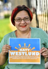House District 13A candidate Katy Westlund holds one of her campaign signs Thursday, Aug. 27, 2020, in Paynesville.