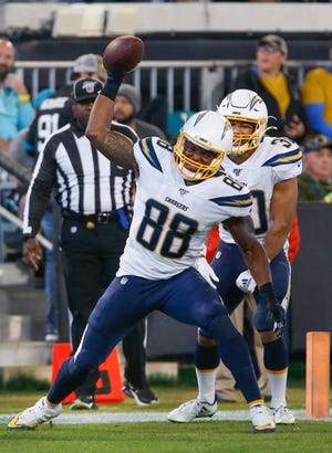 Los Angeles Chargers tight end Virgil Green (88) spikes the ball during the second half against the Jacksonville Jaguars at TIAA Bank Field.