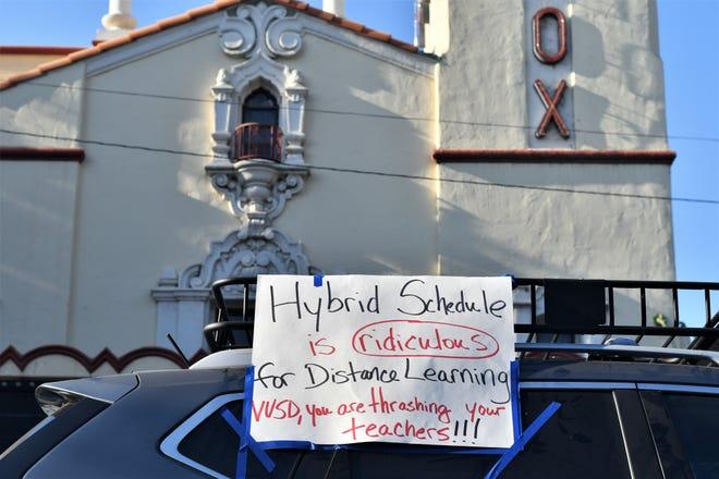 Visalia teachers drove down Main Street to protest the district's A/B Hybrid Schedule, which the Visalia Unified Teachers Association argues shortchanges kids and burdens educators.