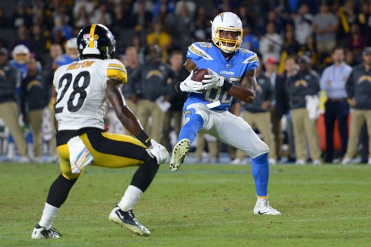 Los Angeles Chargers tight end Virgil Green (88) is defended by Pittsburgh Steelers cornerback Mike Hilton (28) during the fourth quarter at Dignity Health Sports Park.
