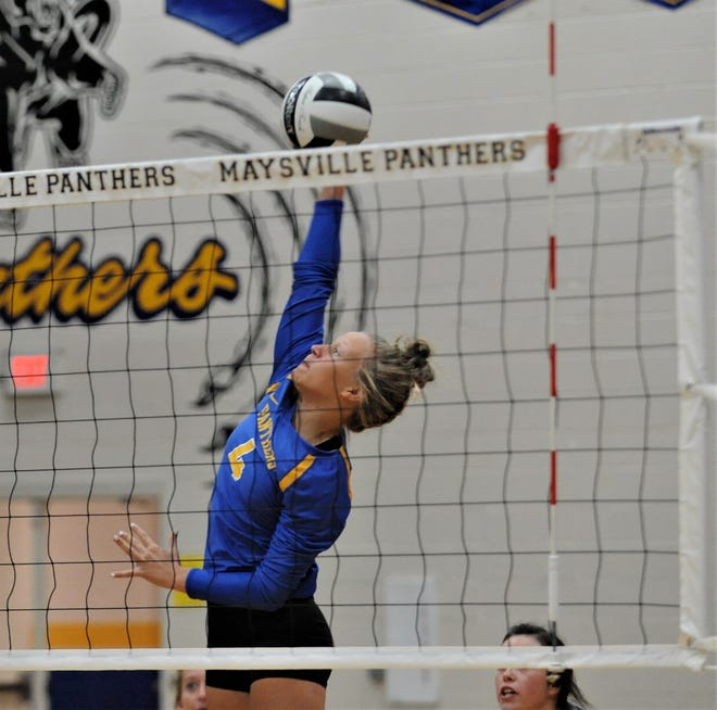 Maysville's Jayda McGarvey hits a kill during Thursday's match against Coshocton.