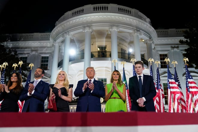 Kimberly Guilfoyle (from left), Donald Trump Jr., Tiffany Trump, President Donald Trump, first lady Melania Trump and Barron Trump stand Thursday on the South Lawn of the White House on the fourth day of the Republican National Convention in Washington. [AP Photo/Evan Vucci]