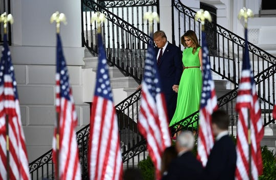 President Donald Trump and first lady Melania Trump walk down the steps of the White House ahead of President Trump's Republican nomination acceptance speech.
