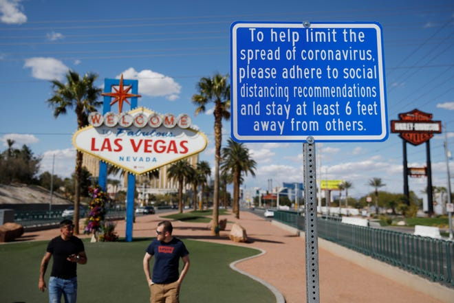 Tourists and air travelers are beginning to return to Las Vegas, but mostly by highway and well below pre-coronavirus pandemic levels, according to an airport and convention authority data released Thursday, Aug. 27, 2020.