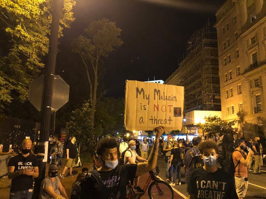 Protesters gather near the White House in advance of President Trump's speech on the final night of the Republican National Convention.