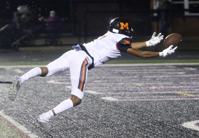 Marlington's Rome Sims reaches for a long pass in the end zone against Alliance during last Friday's game at Mount Union Stadium.