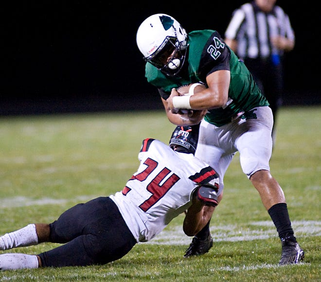 West Branch's Alek Wilson works to break a tackle by Salem's Blaize Exline in an Eastern Buckeye Conference game at Clinton Heacock Stadium Friday, August 28, 2020.