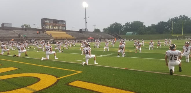 The Ashland High football team goes through its pregame stretches on the field of George Finnie Stadium before its season opener on Friday against Berea-Midpark. The Arrows won, 19-18.