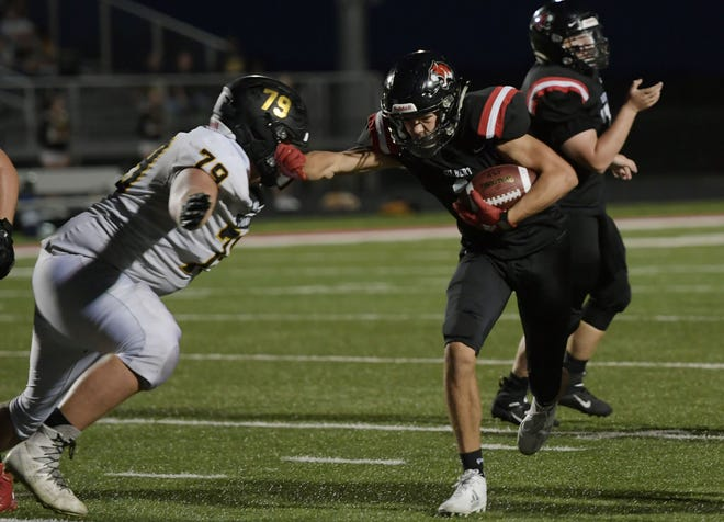 The Gilbert football team won a 34-33 overtime thriller over Adel-Desoto-Minburn Friday in Adel. Birk Hanson, seen here competing in last week's season opener against West Marshall, and the rest of the Tigers are now 2-0 to start off the Graham Lundt era.