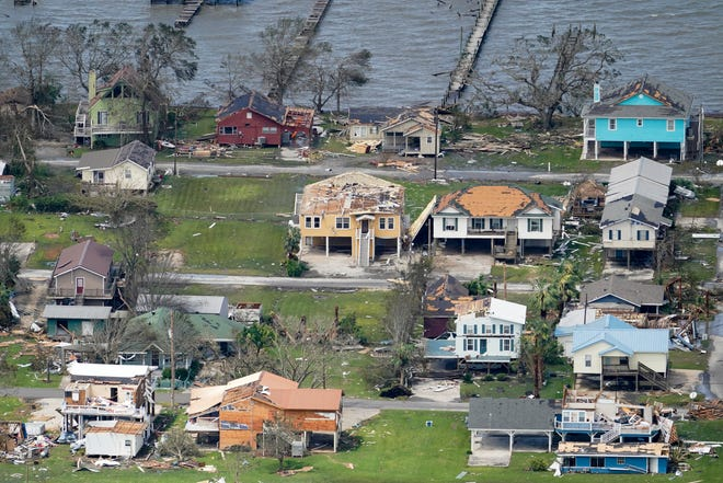 Buildings and homes are damaged in the aftermath of Hurricane Laura on Thursday near Lake Charles.