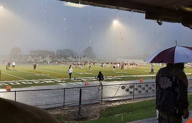 Rain began to pour as the storm came through Friday evening at the start of the Meadowbrook versus John Glenn week one football game in Byesville. The game was cancelled and was rescheduled for Saturday night.