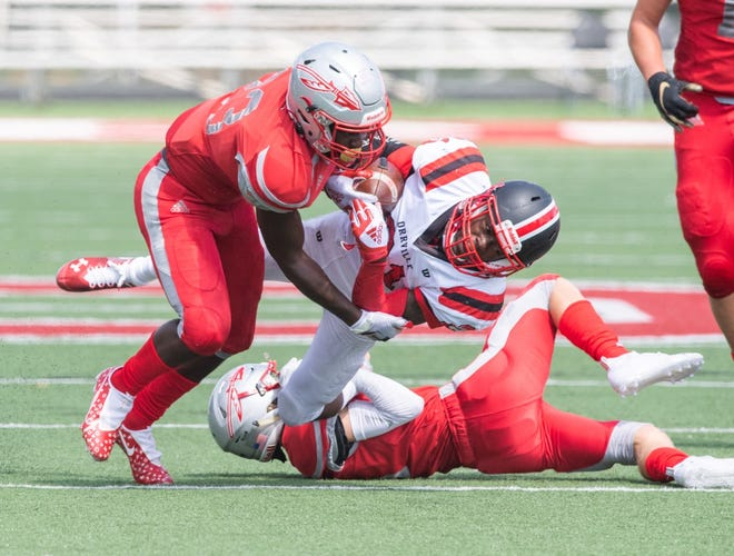 Northwest's Anthony Grossnickle tackles Marquael Parks during the Indians' 42-7 win.