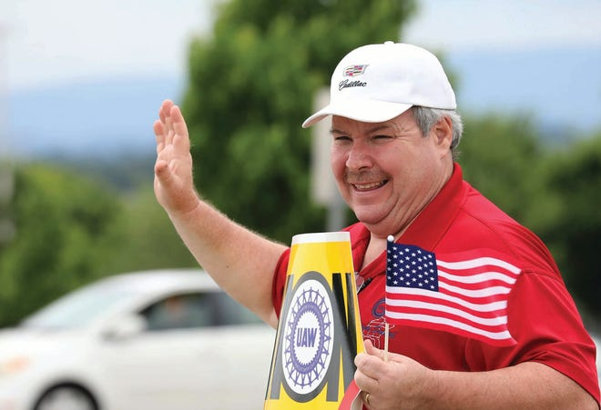 UAW Local 1853 Chairman Mike Herron waves to supporters during the 2019 General Motors strike.
