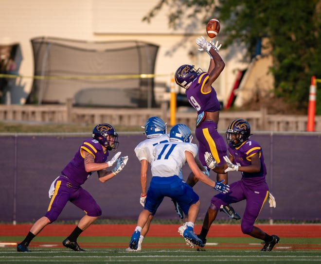 Blue Springs receiver Demerus Walker (19) leaps for a catch in the season opener against Liberty Friday at Peve Stadium. Blue Springs fell behind 37-7 at halftime and fell 46-28 to the Blue Jays.