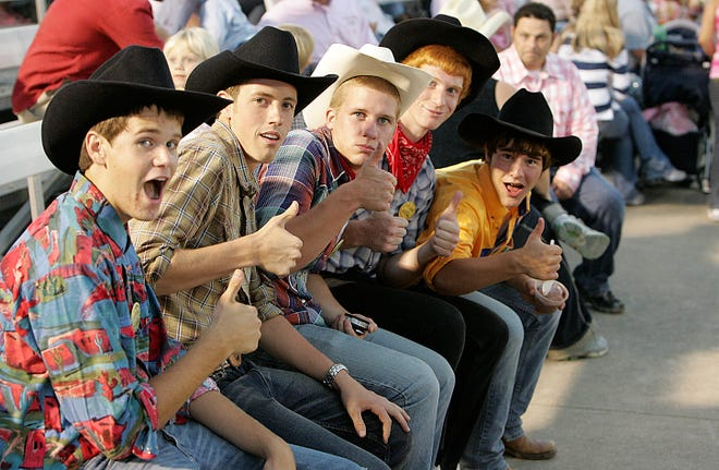 Fans give a thumbs up for the Tri-State Rodeo Sept. 5, 2007 at C.E. Richards Arena in Fort Madison. On Friday, The Rodeo cancelled the 2020 event.
