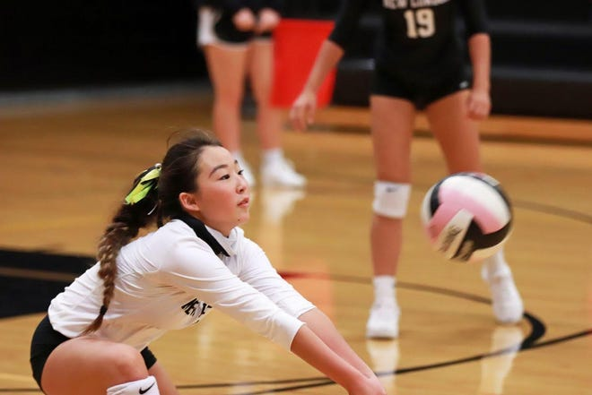 New London's Kyra Linkin bumps the ball in the New London Volleyball Tournament Saturday in New London.