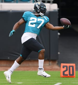 Leonard Fournette pulls in a one handed catch during drills at the start of Saturday's practice session at TIAA Bank Field. Fournette agreed to a contract with the Tampa Bay Buccaneers on Wednesday, two days after being cut by the Jaguars.