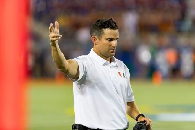 Miami Hurricanes coach Manny Diaz is counting on Houston transfer D'Eriq King to restore the program's reputation as Quarterback U. [Matt Pendleton/Gainesville Sun Correspondent]